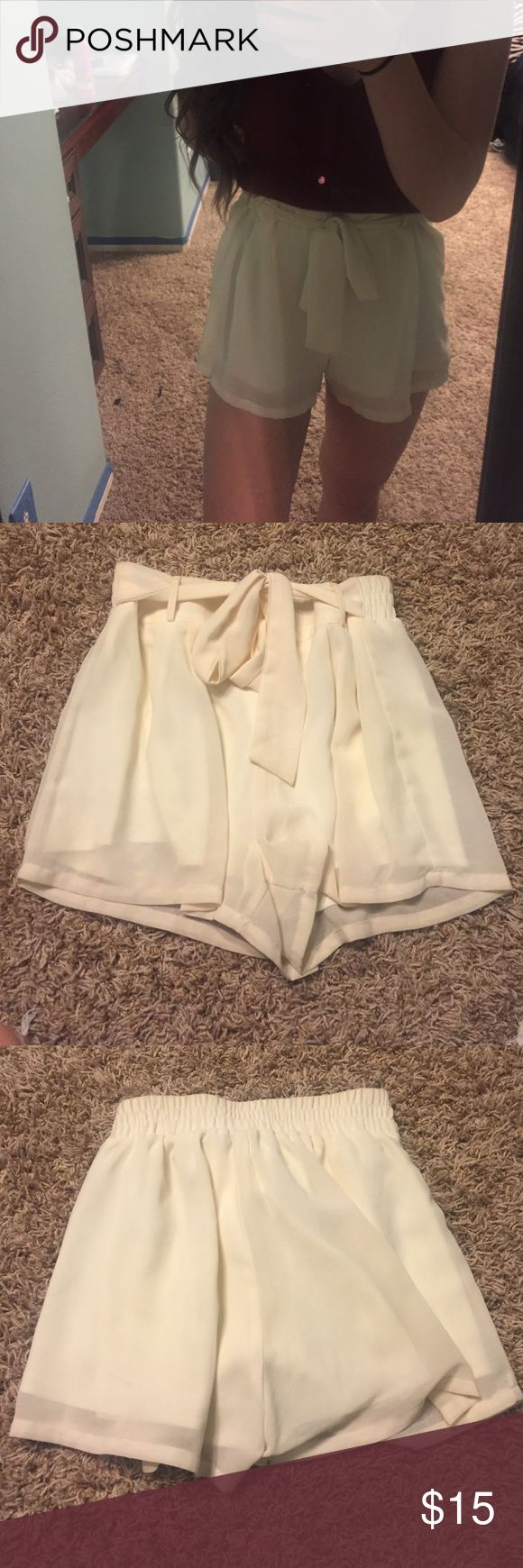 cream shorts option to wear high waisted or low rise. The how does untie to suit you. Super cute , usually worn with a black crop top & black gladiator sandals. I'd say it fits a small / medium because I am a small &  they are a medium. Feel free to make offers of course! Shorts