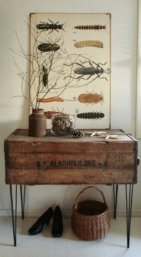 Rustic console made from an old shipping crate and mid century hairpin legs with interesting poster and natural elements