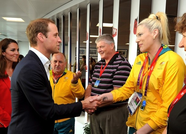LONDON - UNITED KINGDOM - AUGUST 03:  Prince William, Duke of Cambridge meets basketball player Lauren Jackson of Australia, their flagbearer at the opening ceremony, as Catherine, Duchess of Cambridge during a visit to the Team GB House, the main operations centre situated in the Westfield Centre in Stratford on August 3, 2012 in London, England. The Duke and Duchess of Cambridge had requested the visit be arranged in order to allow them to say thank you to volunteers for playing their part…