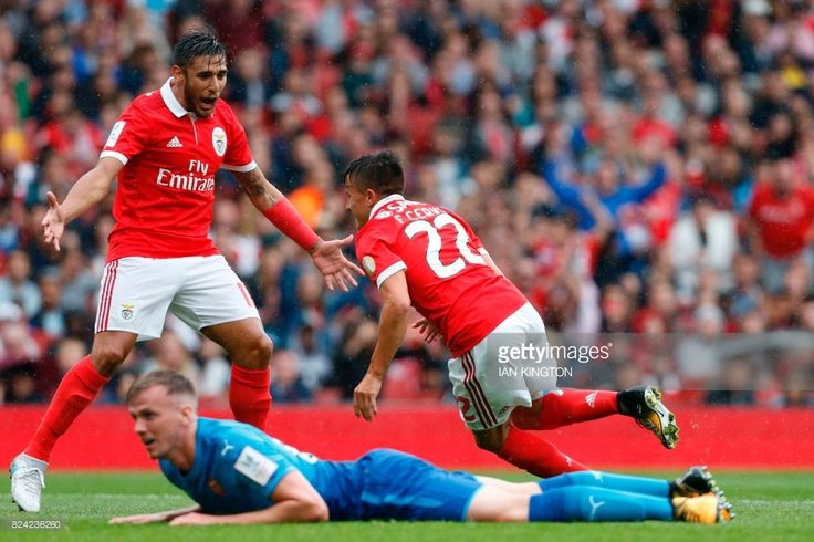 Benfica's Argentinian striker Franco Cervi turns to celebrate with Benfica's Argentinian striker Eduardo Salvio (L) after scoring the opening goal of the pre-season friendly football match between Arsenal and Benfica at The Emirates Stadium in north London on July 29, 2017, the game is one of four matches played over two days for the Emirates Cup. / AFP PHOTO / Ian KINGTON / RESTRICTED TO EDITORIAL USE. No use with unauthorized audio, video, data, fixture lists, club/league logos or 'live'…