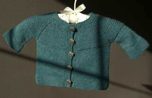 Here's the German translation - Baby Cardi Kraus rechts gestrickt, courtesy of Susanne.