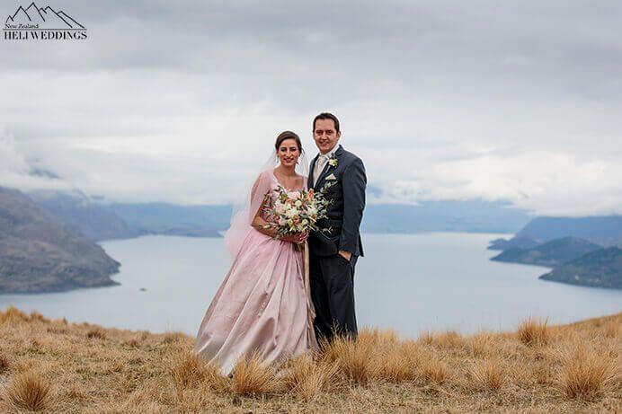 heli wedding in Queenstown. Bride wears pink dress