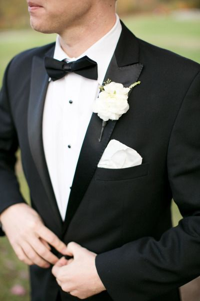 "Let's face it gentlemen, this might be the only day you can suit up like James Bond so why not look dapper in the the black suit and bowtie? A handsome look that will have your bride running down the aisle to say ""I do!"""