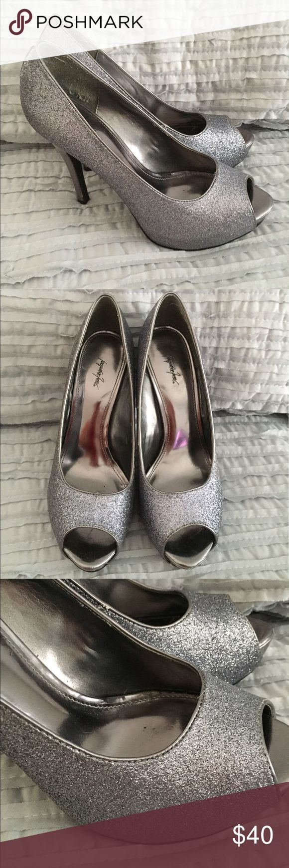 Glittery peep toe pumps Perfect for holidays or any dress up occasion. Glittery peep toe pumps in a silvery pewter color. Worn once Shoes Heels