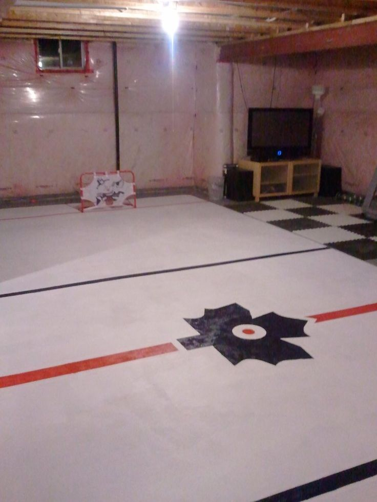 Painted Hockey Arena On Concrete Basement Floor Hockey