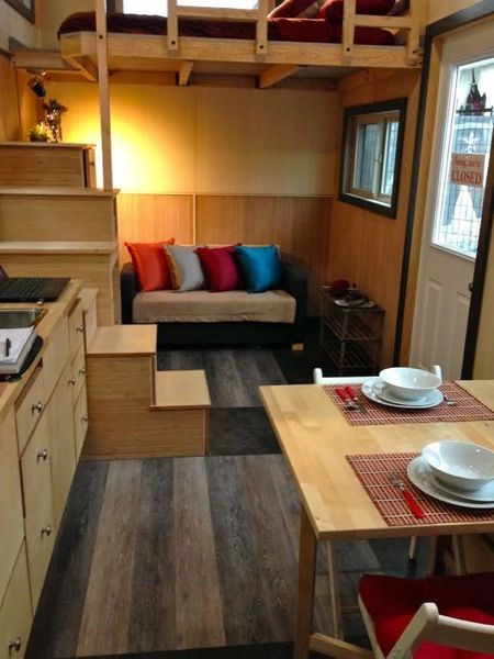 Main floor space design in this 208 Sq. Ft. Tiny House has ample space for a sofa or small bed. | Tiny Homes