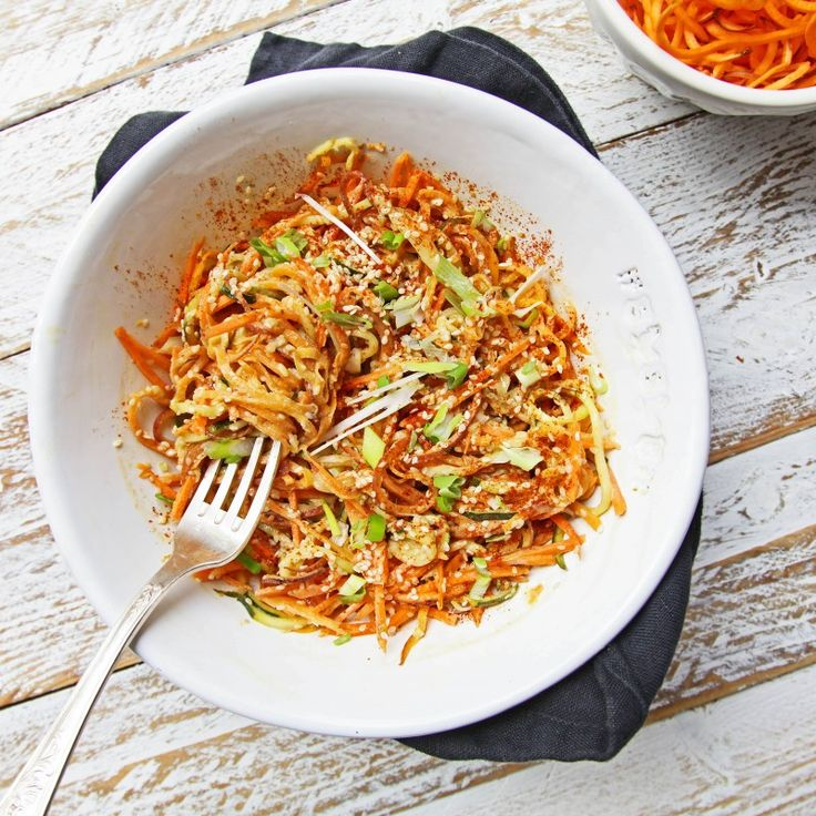 Thai Courgetti Salad - Madeleine Shaw       Serves 2     Salad     2 courgettes     2 carrots     1 cucumber     2 spring onions     1 chilli     Dressing     4 tbsp of tahini     1 crushed garlic clove     1 red chilli     1 tbsp of toasted sesame oil     1 tsp of grated ginger     1/2 lime juiced     4 tbsp of coconut milk     2 tbsp of tamari     1 tbsp of red thai curry paste