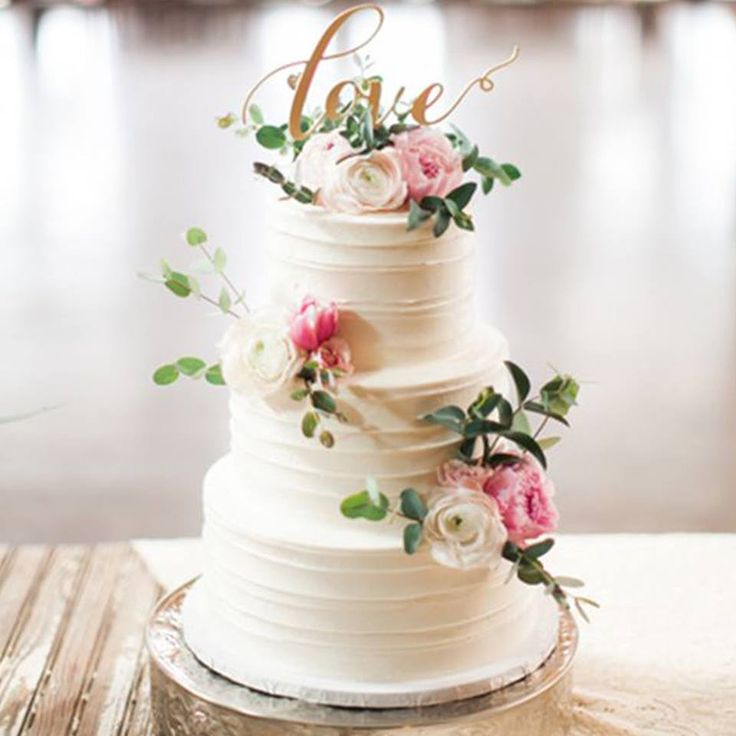 Have you ever seen such a beautiful #weddingcake? What a pretty cake topper! www.wed2b.co.uk