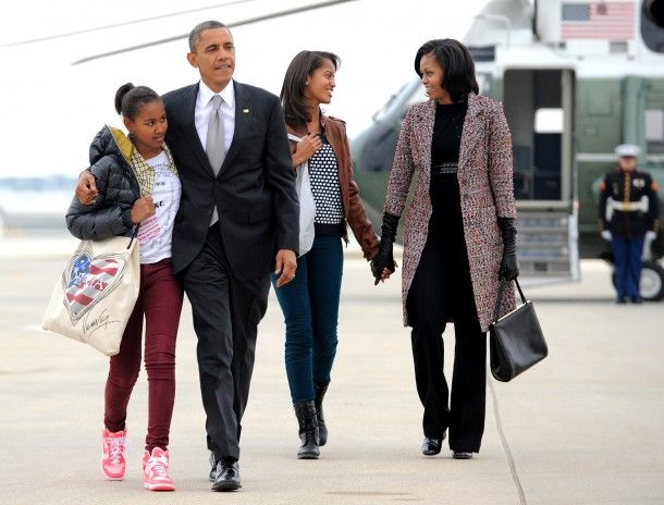 President Barack Obama, First Lady Michelle Obama and their daughters Malia and Sasha board Air Force One at Chicago O'Hare International Airport in Chicago the day after winning the bid for re-election.