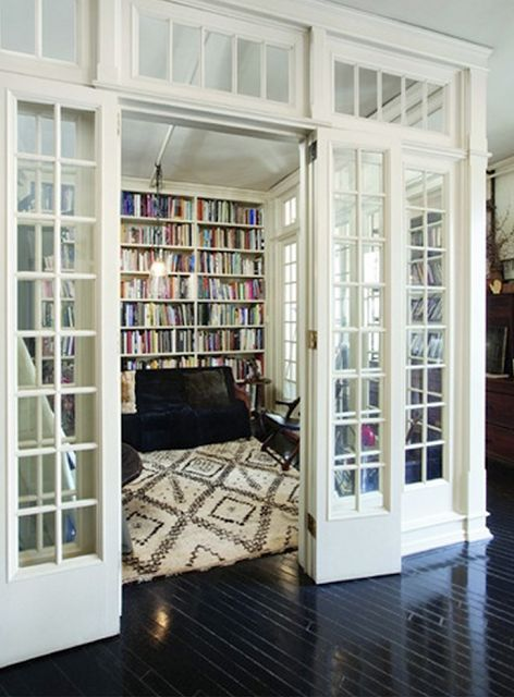 glass walled library, Moroccan rug, ebony wood floors, traditional mullioned windows