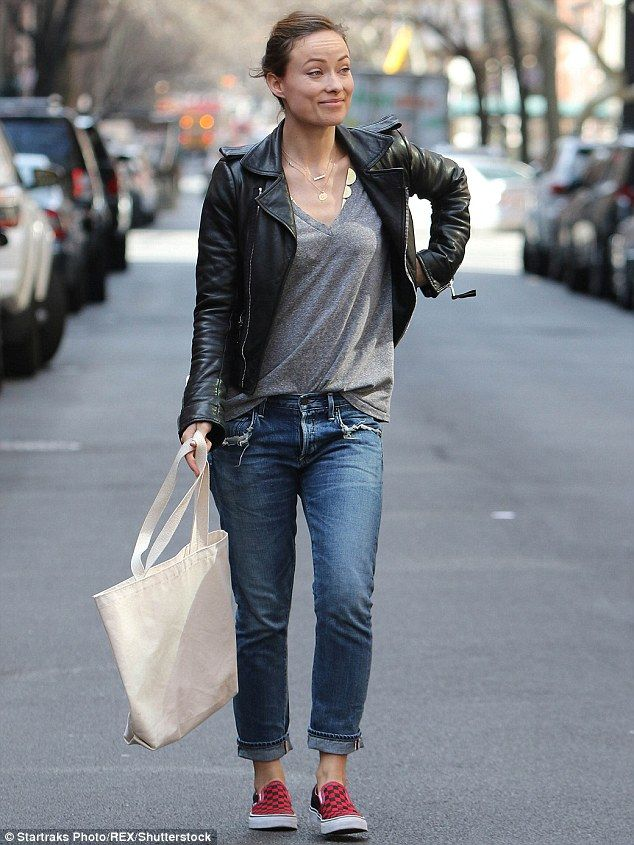 Effortless: Olivia Wilde showed off her svelte frame in a grey T-shirt, jeans and a leathe...