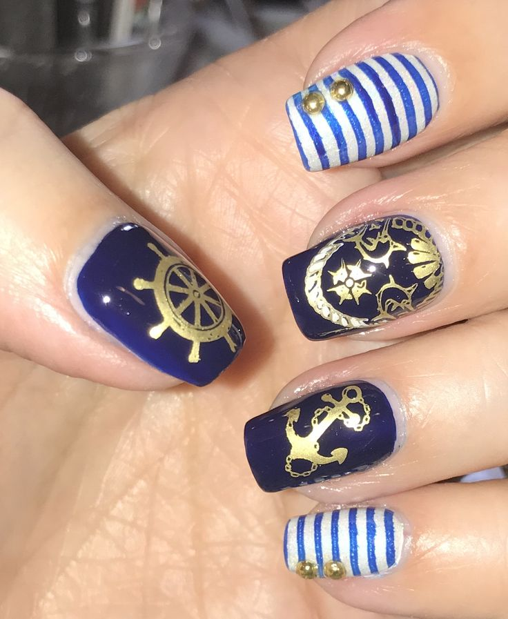 Nautical nails inspired by happy_aries, Ellie Al. I used Mary Kay Blue Debut and Femme Fatale Silent Snowfall for my base colors. I stamped with Hit the Bottle Spun Gold. Stamping plates were a mix of MoYou London and Winstonia nautical plates.