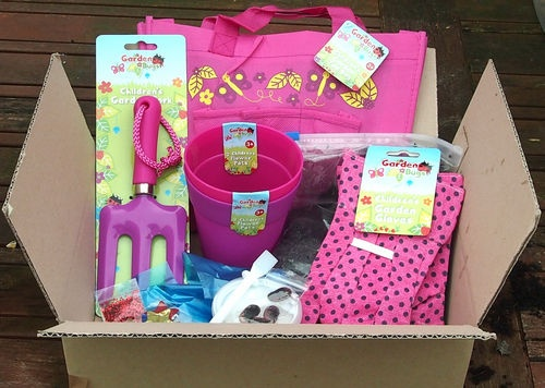Everything to get ur kids gardening: Kids garden set: pots, gloves, bag, seeds, fork, glue, decorating items,compost | eBay  Decorate the pots with the included materials and then plant the seeds!