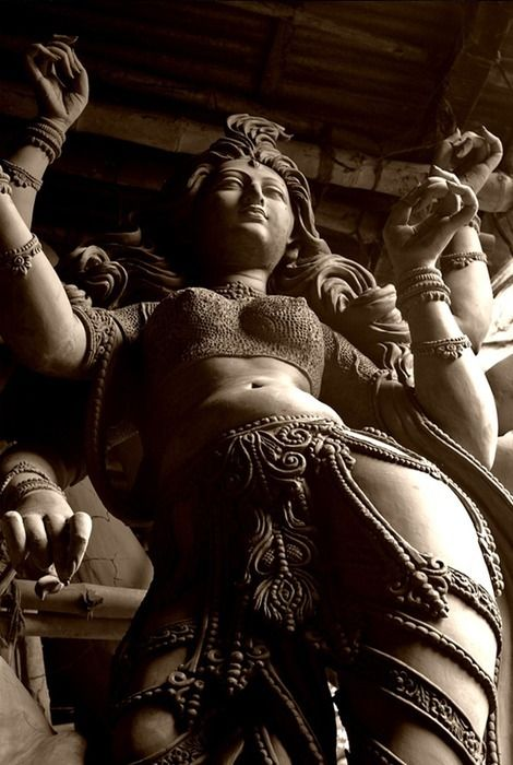 "'Durga statue' in West Bengal photographed by Celina Mahek. ""Durga - Invincible, destroyer of all evil and diseases - she is the embodiment of 'Shakti', a culmination of the powers vested in the Hindu Gods."" via celinamahek on trek earth"