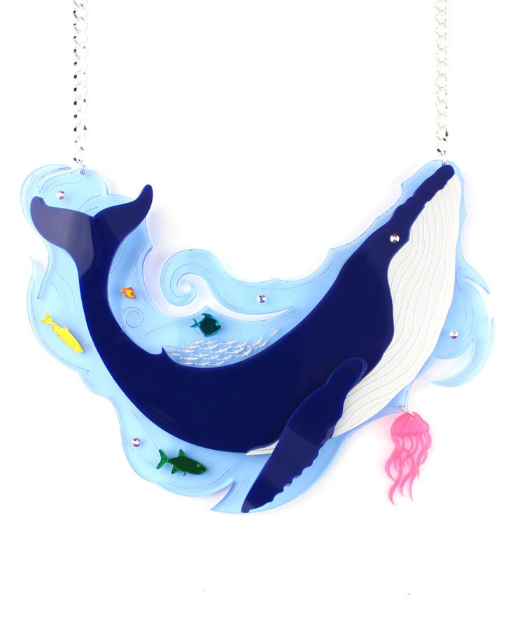 Whale statement necklace, As you navigate the Atlantic ocean on your sailing ship, you see a bank of small fish jump uncontrollably and all of a sudden a big shadow appears under the water. A big blue whale jumps out of the water moving its impressive tail, as it tries to eat as many fish as possible.