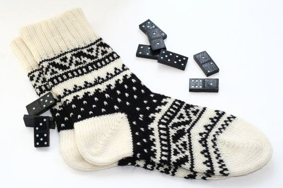 """These socks remind me of the children's book """"The Mitten"""" by Jan Brett"""