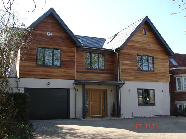 Front view of Oxford house Trinity Properties. PTGV planed 135mm cover western red cedar.