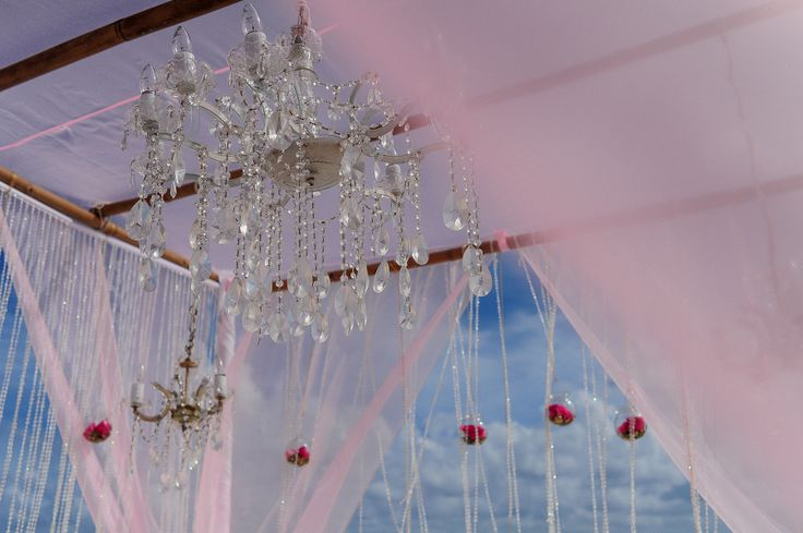 Our clients Hindu Wedding at Playacar Palace, Mexico. Ceremony Set-up with Pink chiffon draping and custom chandeliers.