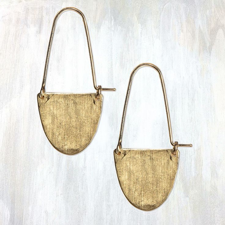 simple and striking, these half moon hoop earrings feature hammered brass with a 14K gold fill ear wire, making them a versatile everyday piece of jewelry #failjewelry
