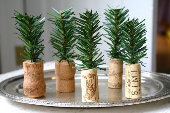 teeny tiny cristmas trees, made out of pine branches and wine corks