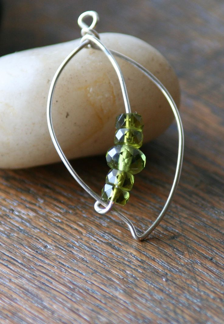wire wrap leaf with green beads, would be a pretty pendant for a necklace or earrings!