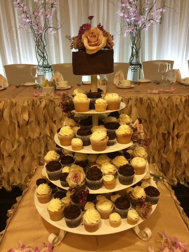 Wedding cutting cake and cupcake tower from real Vancouver, BC wedding.  #createweddingsandevents #vancouverweddings