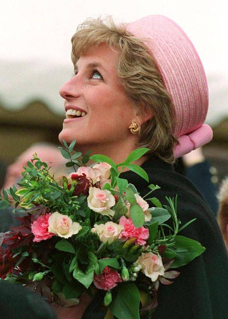 Such a beauty for all time:  Princess Diana was photographed during a visit to the Queen's and Royal Hampshire Regiment at Howe Barracks, Canterbury, Kent, in May of 1995. Diana wore a gold lover's knot earrings and a pink Philip Somerville hat.