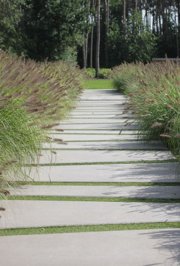 Fountain Grass bottlebrush plumes enhance this interesting and inviting walkway. Eurodal