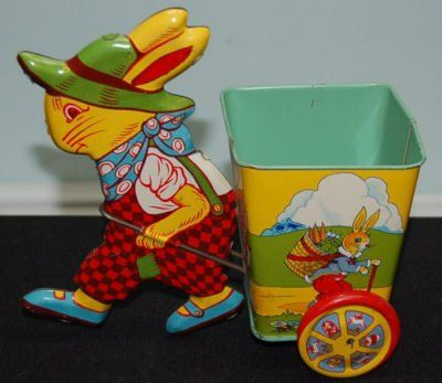 How cute is this retro tin Easter toy?  I want to fill it with bright colored treats (or flowers).