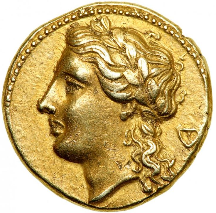 Sicily, Syracuse. Agathokles. 317-289 BC. Electrum 50 Litrai (3.60g). EF Ca. 310-306/5 BC. Laureate head of Apollo left; behind, kantharos. ΣYPAKOΣIΩN, tripod-lebes; above, phiale. Jenkins grp. B, dies O1/R1; cf. SNG ANS 621 (same rev. die, different. symbol); SNG Munich 2 (same dies); BMC 262 (same obv. die). Delicately toned. Estimated Value $2,500 - 3,000 #Coins #Ancient #Silver #MADonC