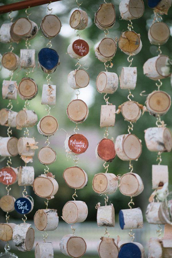 wood slice escort cards, photo by Jordan Weiland http://ruffledblog.com/opulent-florida-wedding-inspiration #weddingideas #seatingcharts