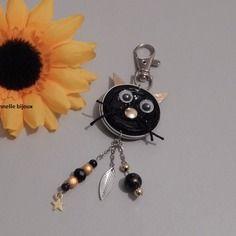 Bijou de sac forme chat avec capsules nespresso noir et doré