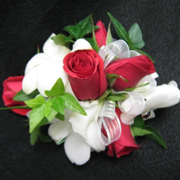 Classic red roses and pure white dendrobium orchids with ivy for the wrist.