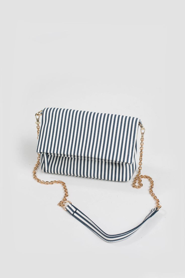 Our perfect Spring/Summer bag is here and you need to get it before it's out of stock! The Bailey Striped Gold Chain Purse is super cute and versatile. Wear it as a crossbody or wear it as a clutch. I