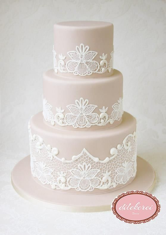 Our beautiful wedding cake with hand piped intricate lace!