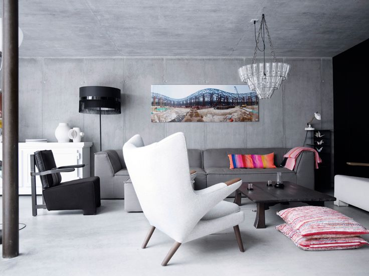 Around the ancient Japanese coffee table from the 1920s is a gray 6905 Gelderland Sofa designed by Scholten & Baijings and PP19-chair by Hans J. Wegner from Klassik.dk. The white dresser Paper Buffet is made of paper and was designed by Studio Job, while the black standard lamp Fringe 5 is from Studio Edward van Vliet (Sevva) for Moooi, and Chandelier Milk Bottle was designed by Bonne Plat for Leitmotiv. Pillows and blankets are designed by Scholten & Baijings for Thomas Eyck