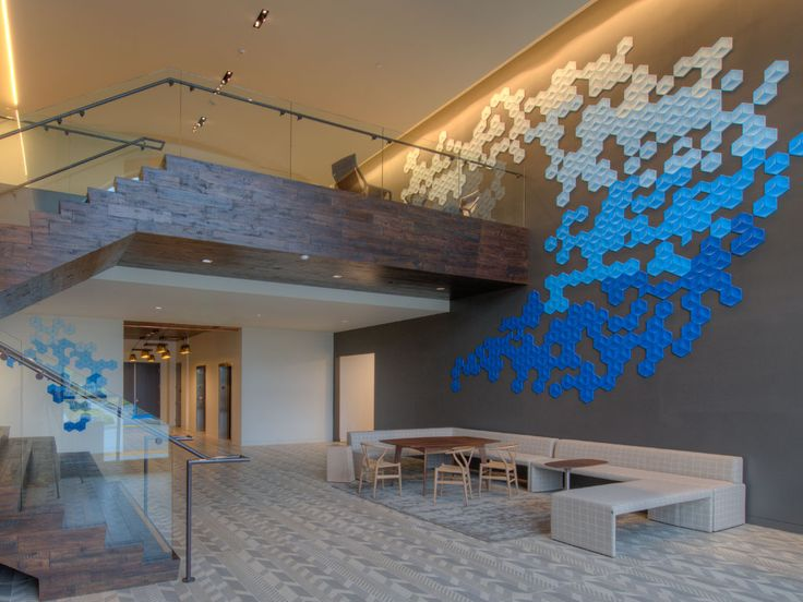 3Form profile tiles in beach tones create an intriguing visual texture in the San Diego building lobby.