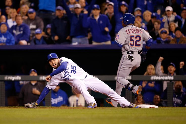 WORLD SERIES GAME 2 - The Mets' Yoenis Cespedes, right, is safe at first base as the Royals' Eric Hosmer is pulled off the bag in the fourth inning of Game 2 of the World Series at Kauffman Stadium on Oct. 28, 2015. (Photo by Christian Petersen/Getty Images)