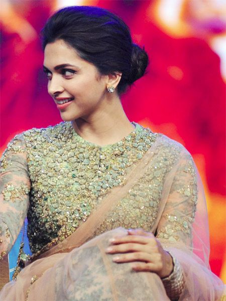 Deepika Padukone: Deepika Padukone was spotted in a messy bun hairstyle during a promotional event for her upcoming film, Happy New Year.