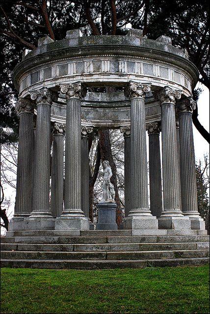 The Caprice Park. Madrid, Spain. Monumento de Baco. El Parque de El Capricho es un parque y zona verde situado en el barrio de la Alameda de Osuna, en el distrito de Barajas, al noreste de la ciudad de Madrid, España. Fue mandado construir por la duquesa de Osuna entre 1787 y 1839. Cuenta con una superficie de 14 hectáreas.