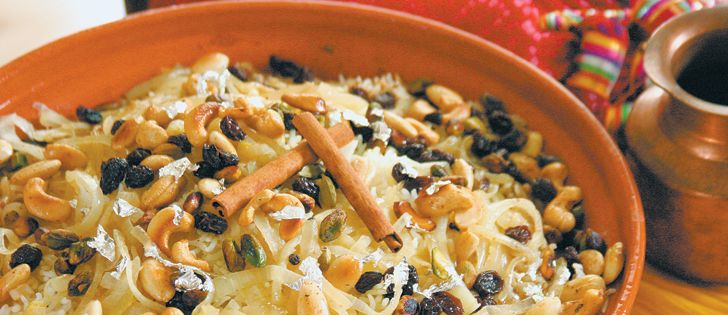 "WP 4 INDIAN: RAITA; Chicken TIKKA Masala; LAMB BIRYANI garnished w/edible silver leaf, spices, dried fruit & nuts; Vij's COCONUT KALE from Vij's Restaurant, Vancouver. ""Enjoy Indian food, British style."" Recipe. ~ The Western Producer"