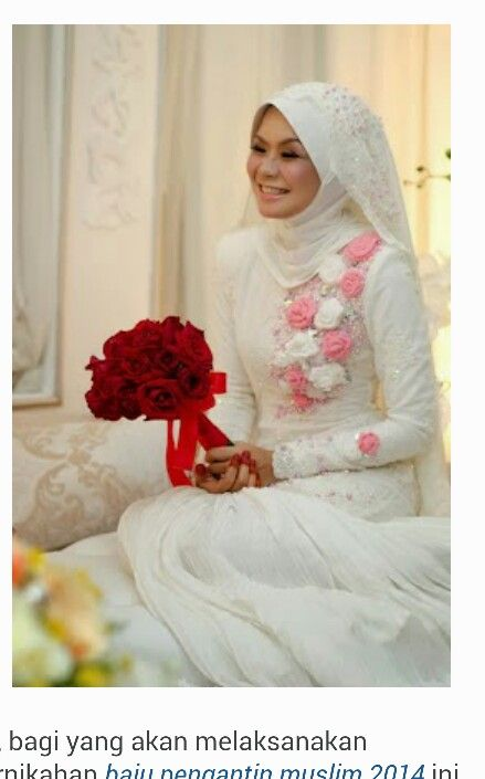 Red handbouquet on white dress