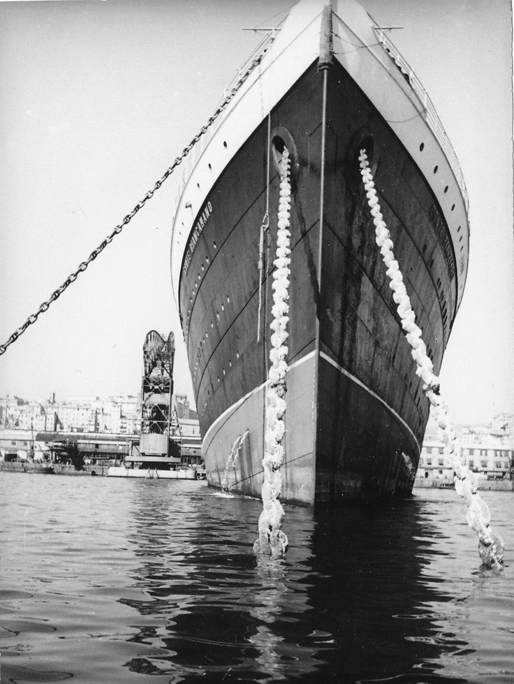 """Il transatlantico """"Conte Biancamano"""", della compagnia di navigazione di linea genovese Lloyd Sabaudo, nel Porto di Genova (anni 1925-1950) / SS Conte Biancamano, an Italian liner launched in 1925, in the port of Genoa"""