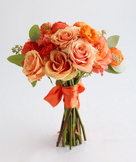 Peach and Orange Roses Blooming orange ranunculus and seeded eucalyptus fill a bouquet of peach and orange roses that's perfect for the traditional bride.