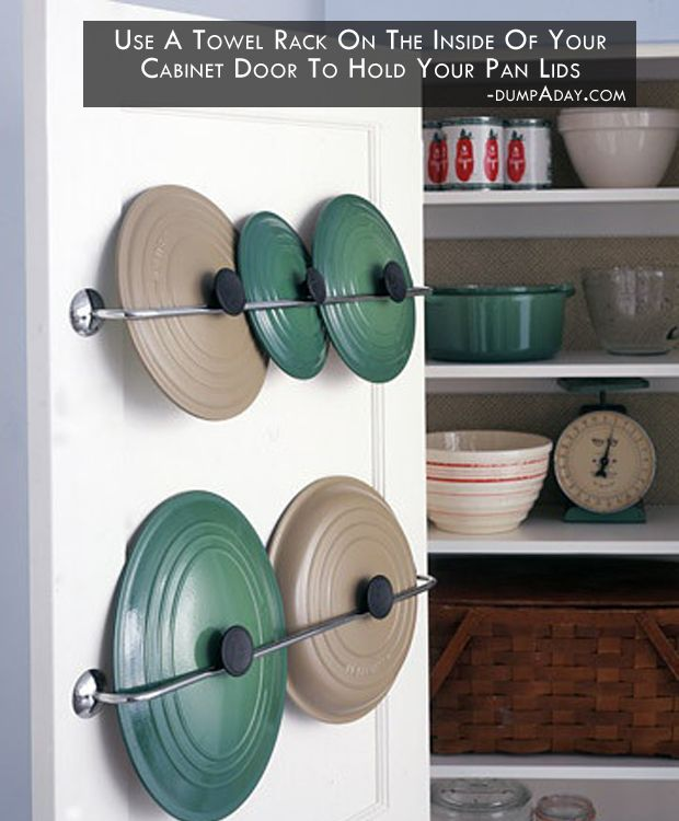 I love this idea! Use a towel rack on the inside of your cabinet door to hold your pan lids.