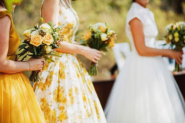 love the fun pattern and the colors. If we incorporate yellow in the dresses, lets not have the other person wear navy. - Sarah