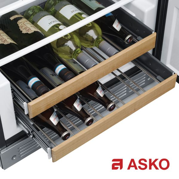 Fully Integrated Wine Chiller and Freezer Fully integrated wine chiller, freezer with electronic ice maker and convertible drawer. The wine chiller holds up to 106 bottles and has dual zone for white and red wine. ASKO's wine fridge is not just storage for your wine bottles, but in fact a small wine care system. In addition to the perfect temperature, it also provides gentle storage on extendable beechwood racks, which run smoothly on telescopic rails with soft close function.