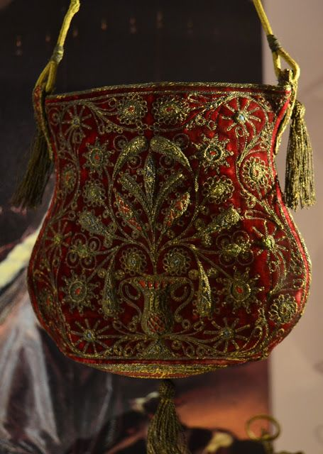 Red velvet with gold thread embroidery and gold thread tassels from the 16th century.Collection Tassenmuseum Amsterdam.
