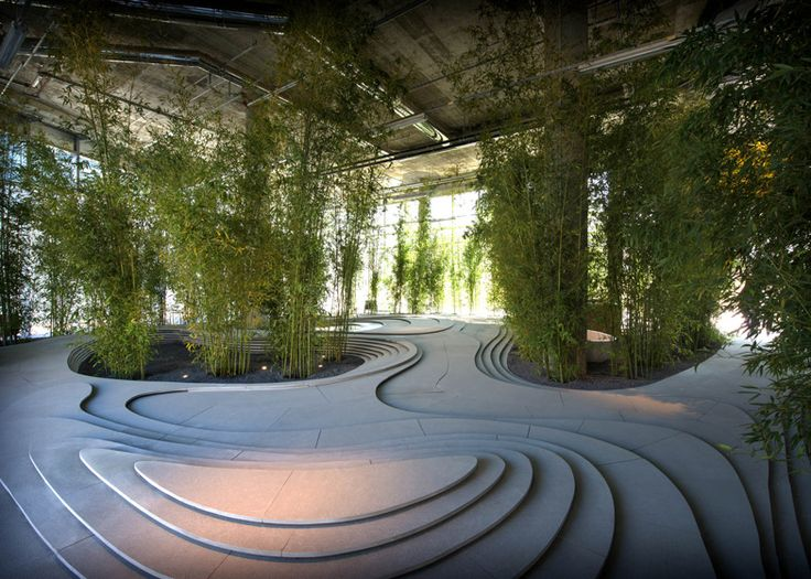 Bamboo trees sprouted up around a topographical landscape of stone and water at this installation created by Japanese architect Kengo Kuma.