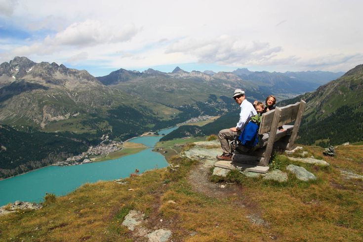 This wonderful panorama trail near St. Moritz has spectacular views, with spiky peaks behind us, lush meadows all around us, and below us, the whole Engadin valley with icy blue Silvaplana lake.
